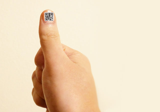 As an example, the QR code nail jell sticker is put on a fingernail.