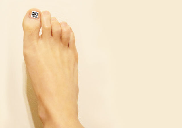 As an example, the QR code nail jell sticker is put on a toenail.
